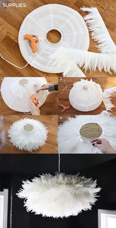 DIY Chic White Feather Chandelier. This feather chandelier really tops off the look and feel of this dining space.