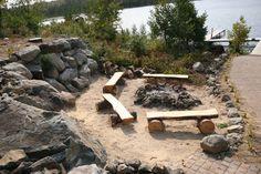 Log seats around fire pit.