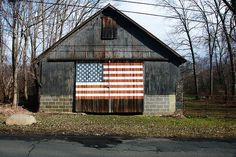 Old barn with painted American flag this old barn