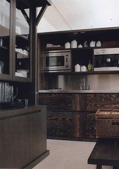 Christian Liaigre beautiful dark rich wood kitchen contrasting against white