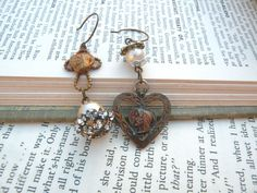 mismatch earrings religious assemblage heart by lilyofthevally