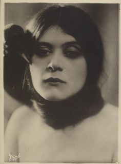 Theda Bara - Famous silent film actress + crow - really close to her eye.