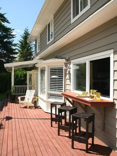 Kitchen window bar. Great for little kids so they aren't running in and out all the time. Love this back deck look!
