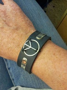 wide black leather bracelet. can be made to order!  all metal is sterling silver except the stainless steel snap!