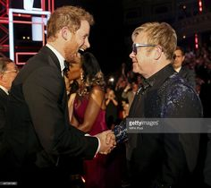 Britain's Prince Harry greets Elton John after the Royal Variety Performance at the Albert Hall on November 13, 2015 in London, England.