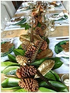 22  Ways to Decorate with Magnolia Leaves   Merry Christmas     lovely centerpiece with magnolia leaves  pine cones and feathers