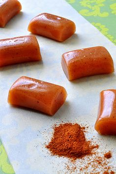 Apple cider caramels  2 cup high-quality apple cider   1 cup heavy cream or whipping cream, divided  1 tsp ground cinnamon  Pinch nutmeg  1/4 tsp allspice  1 1/2 cup sugar  1/3 cup light corn syrup  1/2 cup real butter, cubed