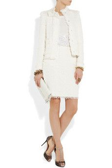Look to cult Parisian brand Lanvin for sophisticated pieces like this cream bouclé-tweed skirt. Hitting just above the knee, this tactile style cuts a chic silhouette. Dress it down with a silk tee and ballet flats, or complete an elegant wedding day look with the matching jacket and your favorite heels.