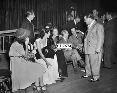 """July 18, 1940: A backstage view at RKO Keith's theater in Syracuse during the world premiere of the movie """"The Boys From Syracuse"""". At far right is comedian Lou Costello and just to the left is his partner, Bud Abbott who is talking with another screen comic Eric Blore. Actress Peggy Moran is seated second from left...Courtesy of Terry Soto Bud Abbott, Comedy Duos, Abbott And Costello, Golden Age Of Hollywood, Comedians, Two By Two, Actresses, Popular, Comics"""