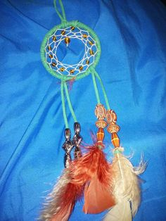 Check out this item in my Etsy shop https://www.etsy.com/listing/448819784/dreamcatcher-with-beads