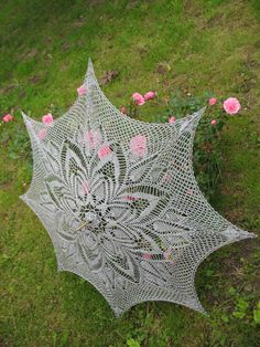 I love the sophisticated classiness of this grey crochet umbrella sold on Etsy by solva.