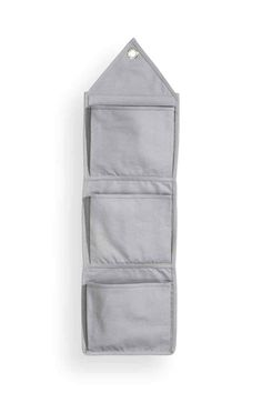 c6efb3e112cbd Wall tidy  Wall-hung canvas organiser with three pockets and an eyelet at  the