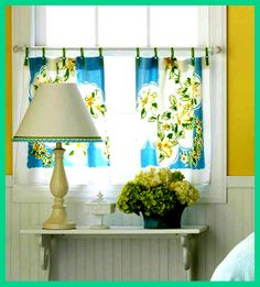 Curtains made from vintage dishtowels and ribbons. Not a fan of the pattern but the idea is neat.