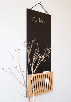 A blackboard with a solid oak unit, handmade embroidered. Special application with black flexible thread to create a decorative and practical feature. The blackboard can be used with chalks, and the wood unit for attaching notes, photos, cards etc.