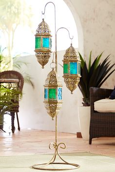 Simulate a night in Casablanca with Pier exclusive Moroccan Hanging Floor Lanterns, crafted of iron and hand-painted glass. Light up your night with candles or LEDs to set an exotic and alluring atmosphere. This could be the beginning of something bea Moroccan Decor Living Room, Morrocan Decor, Moroccan Bathroom, Moroccan Lamp, Moroccan Lanterns, Moroccan Design, Moroccan Style, Moroccan Interiors, Moroccan Lighting