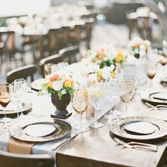Bronze, Moroccan-inspired chargers decorated the tables along with crystal and bronze-colored glasses. Casual Vintage.