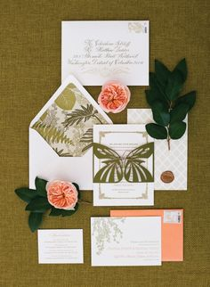 Coral and Moss colored invitation suite! I like that this set is playing on the palm print that is so in right now! Also the butterfly motifs is really pretty!