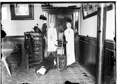 Effigies dressed as ghosts with crosses around their necks and masks hanging in the corner of a room, c. 1906, Chicago, Illinois. Photograph by Chicago Daily News, Inc.DN-004056B #Halloween #Chicago #Ghost
