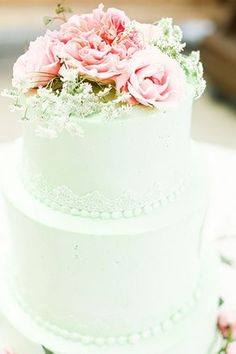 Mint cake with lace and perhaps matching peonies on top.