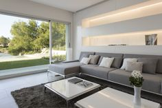 Inspired by Brukman Chechik : Salones modernos de LIVE IN