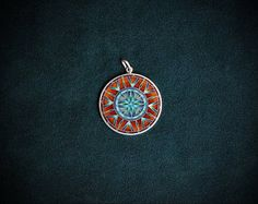 This is a cloisonne enamel pendant, which was made in sterling silver. Item will be sell with silver chain.