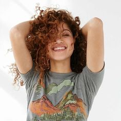 Renée Mittelstaedt.   curly red hair   t shirts   laughing portrait