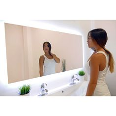This illuminated mirror adds brilliance and style to any bathroom decor. You'll…