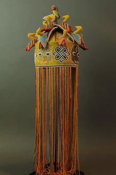 Africa | Fine beaded  crown, 'ade ileke', traditionally worn by a Yoruba king. 'The beaded veil that covers the king's face hides his individuality and increases attention on the crown itself, the real centre of power…'. The birds decorating the crown represent the royal bird, okin. | ca. Mid 20th century.