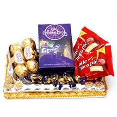 With this hamper, you will be able to send 6 pieces of Ferrero Rochers, 2 Chocopies, 10 Eclairs and box full of Cadburys Celebration. Coming in a ethnically decorated tray, if you send this hamper in India, the recipeint will surely love it. Let your loves ones have a mouthwatering treat with this chocolate and other Gifts to India which you can send through Giftblooms.com.