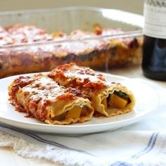 Butternut Squash Lasagna Roll Ups- stuffed with slightly tender squash, kale, and creamy ricotta cheese. Comfort food at it's finest.