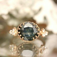 Dark sapphire w/visible inclusions