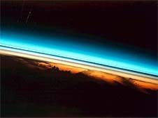 Atmosphere:  The layer of gases surrounding a planet...... *Earth's atmosphere protects life on the planet.  *Earth's atmosphere has five layers.                                 Layers of the upper atmosphere looked at from the edge, shown in colors ranging from red near the earth to blue towards space  This photograph of the colorful layers of Earth's upper atmosphere was taken from the space shuttle, looking sideways across Earth's atmosphere. Image Credit: NASA