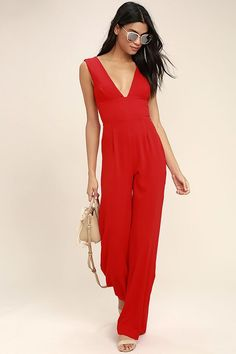 Lulus Exclusive! The Fashion Faithful Red Wide-Leg Jumpsuit will always be a style standout! Woven poly falls from wide straps (with no slip strips) into a plunging neckline and darted bodice. High, set-in waist tops wide-leg pants. Hidden back zipper.