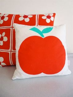 apple by Jane Foster with a Pomme de Jour.com sourced vintage fabric cushion behind.