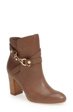 Free shipping and returns on Isolá 'Colleen' Leather Bootie (Women) at Nordstrom.com. Logo-embossed hardware and a clip-lock harness distinguish a polished leather boot set on a stacked heel. A cushioned footbed and breathable lining ensure lasting comfort, while the signature embossed sole provides all-season stability.