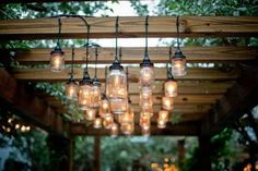 I love the homemade mason jar lights hanging from the pergola. Now I just need some jars and lights and pergola wood. Dan take note, happy wife happy life Pergola Patio, Pergola Kits, Pergola Ideas, Patio Ideas, Cheap Pergola, Wood Pergola, Outdoor Ideas, Backyard Ideas, Wooden Gazebo