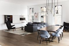 Dining Room in New York, NY by Ashe + Leandro  I think this gives you a good visual of what the dining chairs would look like with grey leather and the dark nickel legs