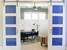 Put color tinted glass in the doors! House of Turquoise: Hiya Papaya + Four Chairs Furniture (Closet? House Of Turquoise, Materials And Structures, Wainscoting Styles, Wainscoting Bedroom, Parade Of Homes, Living Room Lighting, Interior Barn Doors, My Living Room, Sliding Doors