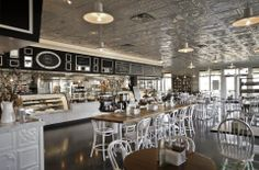 UXUS designed the 'Selland's Market Cafe' in United States. http://en.51arch.com/2014/06/i0032-selland-market-cafe/