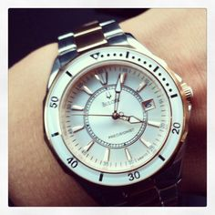 Bulova white silver and rose gold female watch