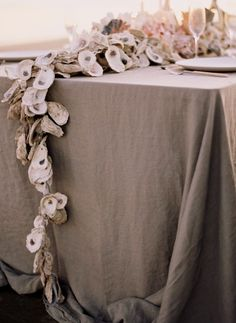DIY Beach Wedding Inspiration Idea - This DIY Oyster Shell Garland is beautiful as a wedding table centerpiece.