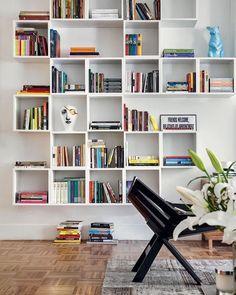 Que tal utilizar nichos no cantinho de leitura? Eles deixam os livros e objetos…