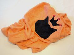 """From now there is no need to use your towels; the cat will have a special personalized towel only for him! A designed orange towel for cats made of 100% cotton.  On the one side of this soft towel there is a cat shape patch that cut, pasted and sewn by the designer. The patch is also made of 100% cotton. The towels sizes : 27"""" x 51"""" (130cm*70cm).  The towel gently washed in the washing machine."""