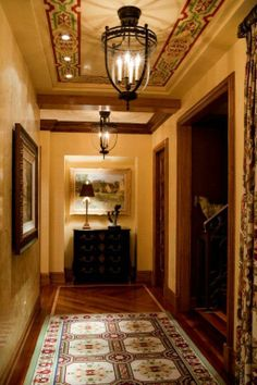 Stenciling is especially useful if walls are painted with a flat paint in hues of brown, beige or blue.  [Warren Sheets Design]
