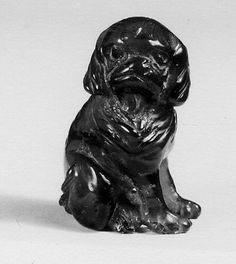 Netsuke of Seated Dog (one of a pair) Date: late 19th–early 20th century Culture: Japan Medium: Amber Dimensions: H. 1 11/16 in. (4.3 cm); W. 11/16 in. (1.7 cm); D. 1 1/8 in. (2.9 cm)