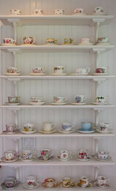 Teacups on display... and to use of course. I think I found something new to start collecting! So beautiful. Reminds me of visiting my Grandma.