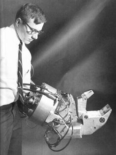 """historicaltimes:  General Electric's """"Handiman"""" """"Man-Amplifier,"""" 1965. restricteddata:   More on this device here. I love the geek + cyborg + Rodin's """"Thinker"""" aspects of this photo."""