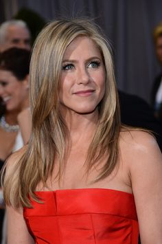 Jen Aniston. For a natural auburn/medium brown, I can't even begin to imagine the time she's spent in her colorist's chair over the years to achieve her trademark, multi-dimensional, golden blonde. -P.S.