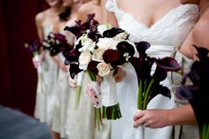 photo by Seattle based wedding photographers La Vie Photography - bouquets with deep red calla lilies and ivory and champagne roses