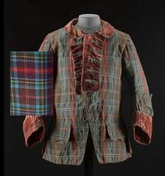 Said to have belonged to Prince Charles Edward Stuart. Man's sleeved waistcoat of yellow silk rep, embroidered with a floral design in silver thread. Short tartan frock coat with velvet collar and cuffs and lined in wool twill and linen. Juxtaposed with a piece of Wilson of Bannockburn's version of the tartan which they called 'Culloden' .